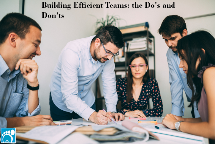 Coworkers learning about building efficient teams