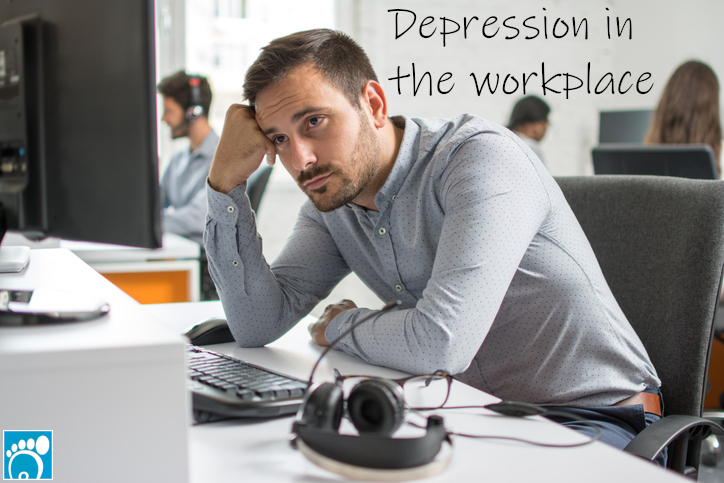 Office worker struggling with depression in the workplace