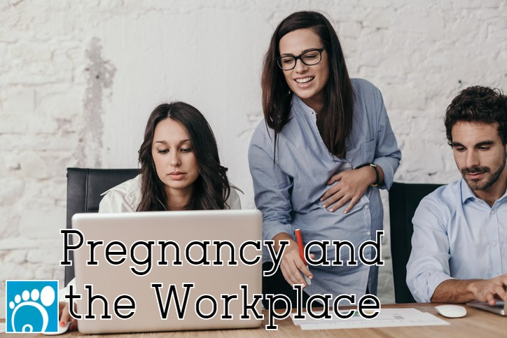 Woman successfully managing pregnancy and the workplace